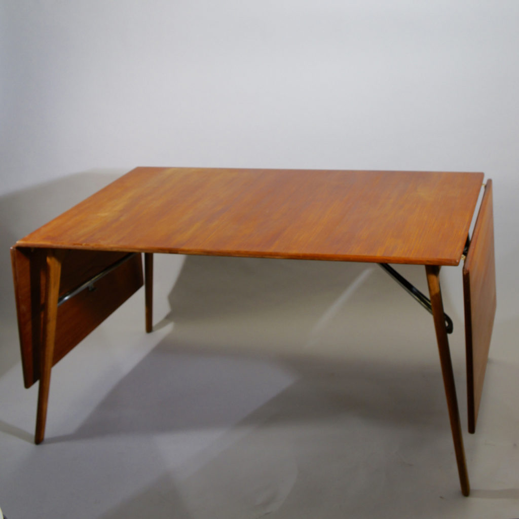 Børge Mogensen for Søborg Møbelfabrik. Dining table for approx. 10 guests in teak and oak with two drop leaf hold up by steel rods. L 240 D 93 H 73 cm