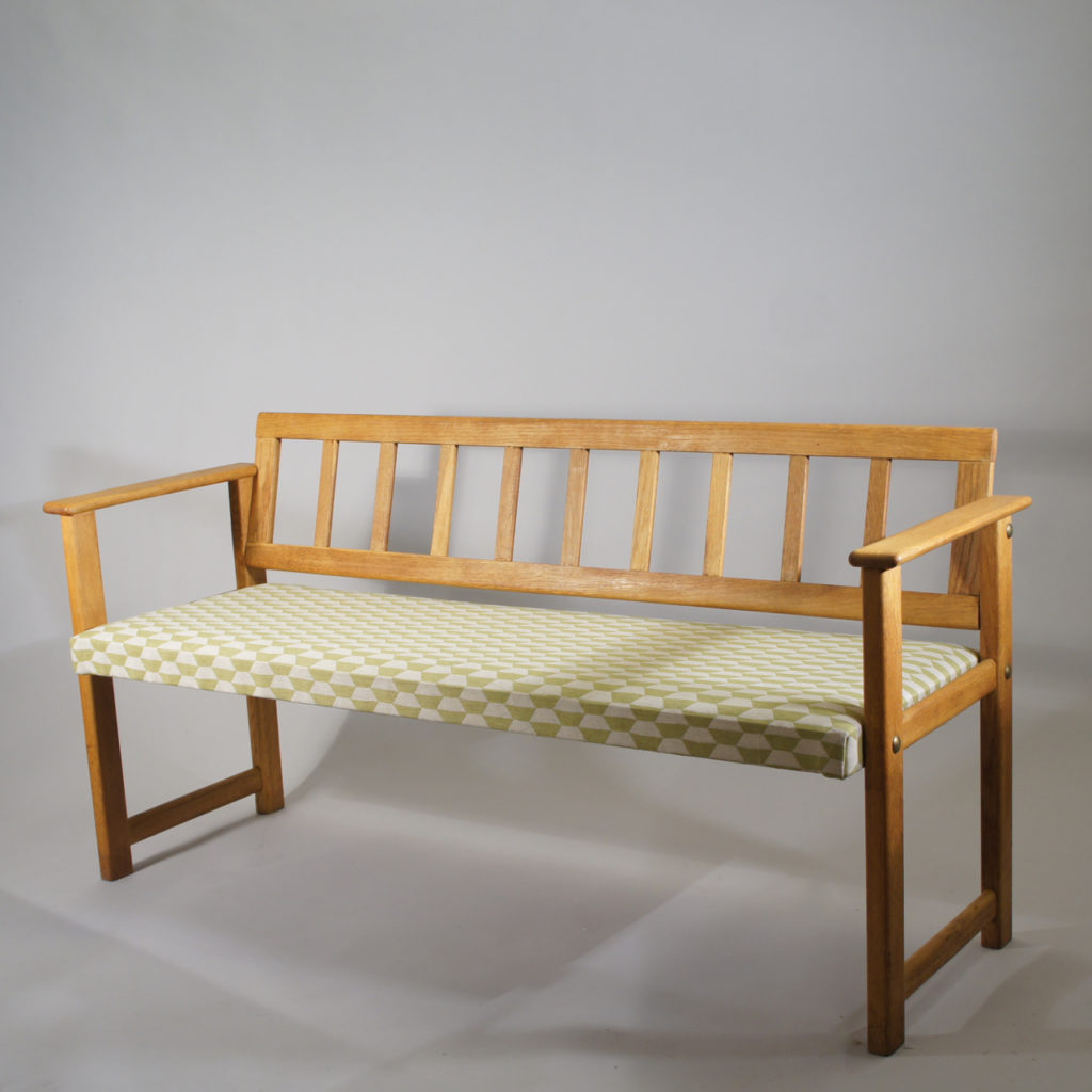Sofa in oak with seat covered in fabric. Maker unknown. Lenght 140 cm.