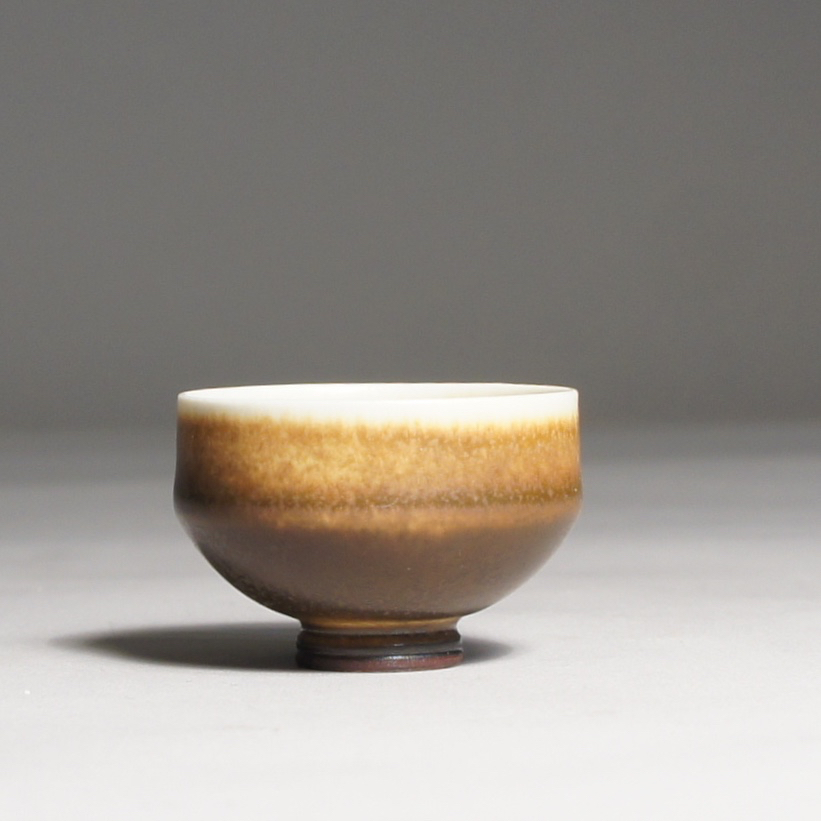 Berndt Friberg for Gustavsberg. Miniature bowl in stoneware with harefur glaze. Height 2,5, diam 2,5 cm.