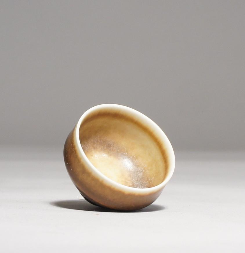 Berndt Friberg for Gustavsberg. Miniature vase in stoneware with harefur glaze. Height 2,5, diam 2,5 cm.