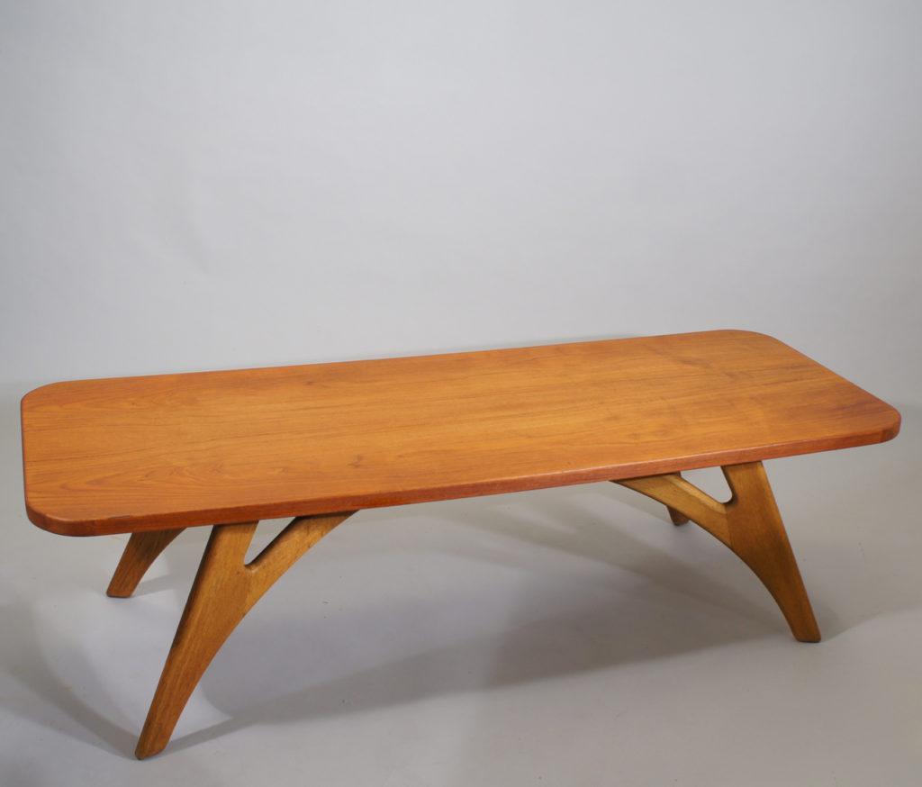 Coffee table in teak with legs in oak by Kurt Østervik, Jason Møbelfabrik, Denmark. 150x55, height 43 cm.