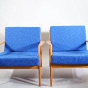 """Folke Olsson for Dux, Sweden. """"USA 75"""". Easy chairs in teak."""