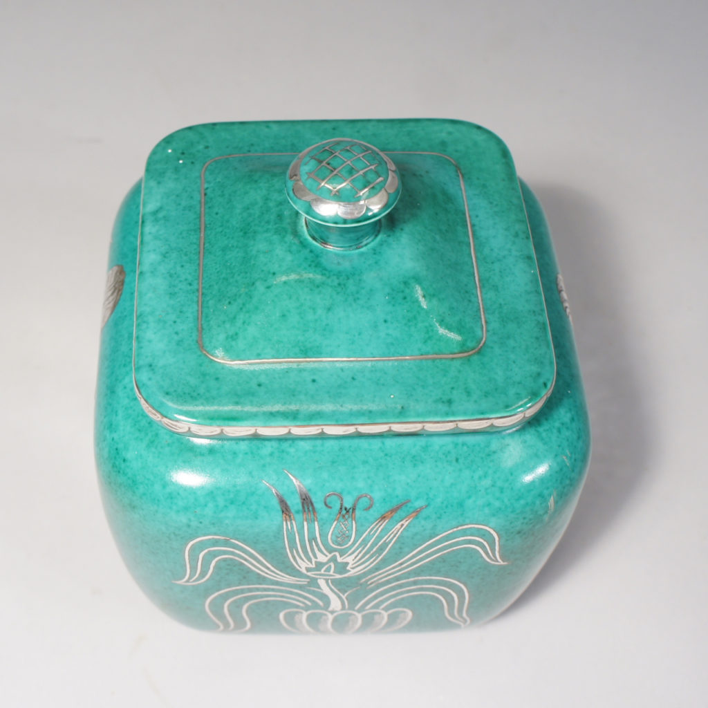"Wilhelm Kåge for Gustavsberg. ""Argenta"". Urn with lid in green stoneware with decoration in silver paint."