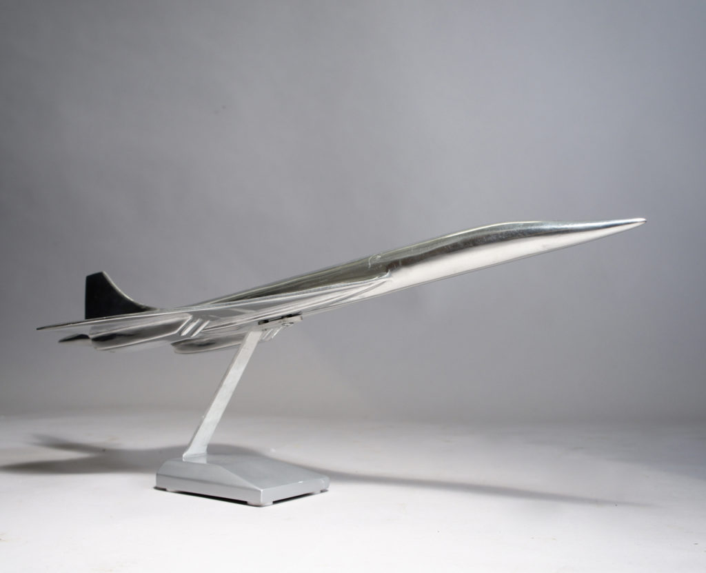 Model of the jet airliner Concorde in aluminium on stand