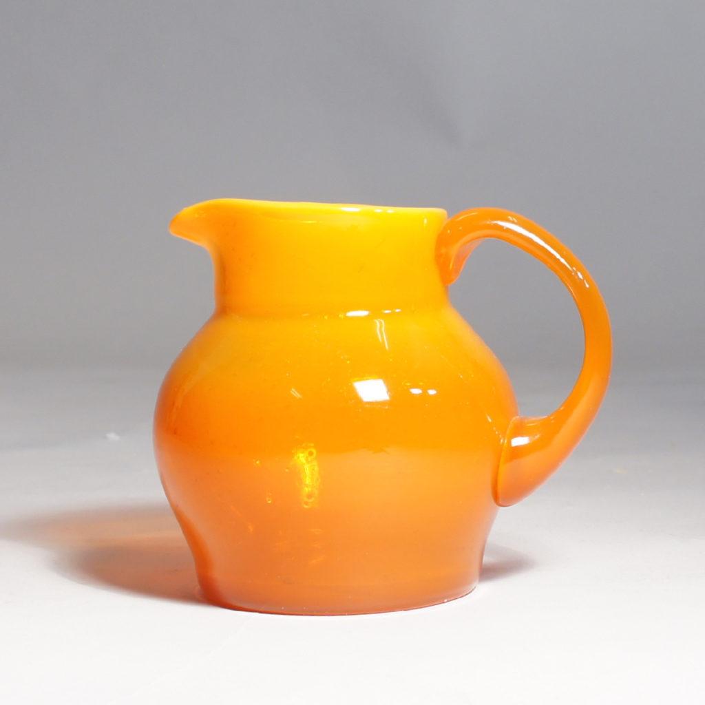Erik Höglund for Kosta. Signed jug in orange glass.