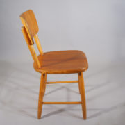 Four dining chairs in beech and teak.