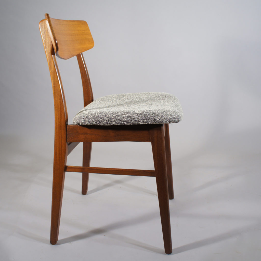 Four chairs in teak. Made in Denmark. New upholstered seats.