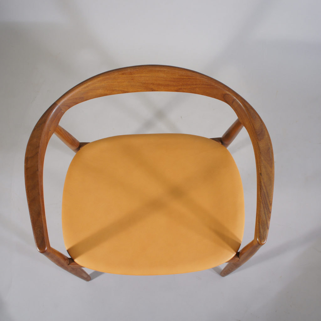 """Kai Kristiansen for Ikea 1960s. """"Troja"""". Armchair in solid teak and new seat in leather."""