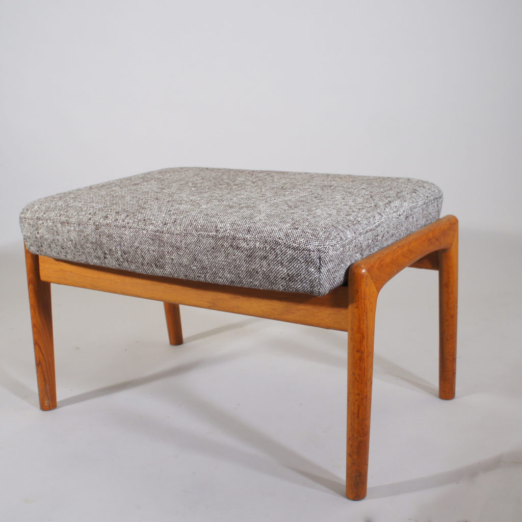 Folke Ohlsson for Dux, Sweden.Ottoman in teak with new upholstered seat in wool fabric.
