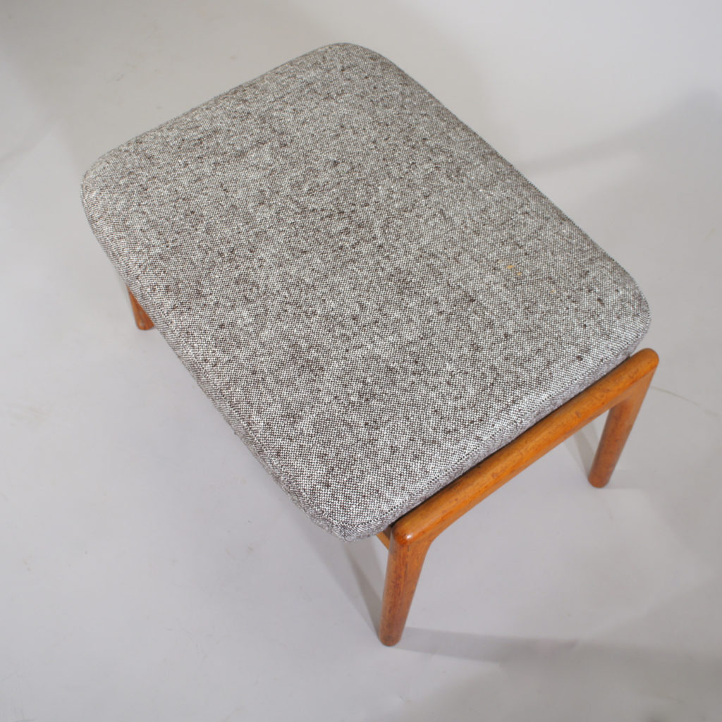 Folke Ohlsson for Dux, Sweden. Ottoman in teak with new upholstered seat in wool fabric.
